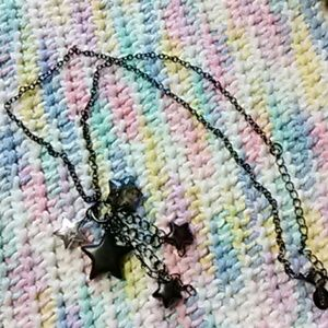 Claires black star dangle necklace